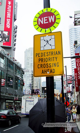 Scramble Intersection at Yonge Street and Dundas Avenue Sign